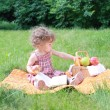 Small lovely girls with fruits in the park — Stock Photo