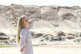 Beautiful blond girl in the sunny day — Stockfoto