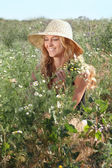 Blond girl on the summer meadow — Stock Photo