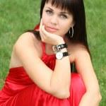 Brunette girl in red — Stock Photo