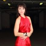 Girl in red in the dark — Stock Photo