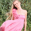Girl in the pink dress with roses — Stock Photo #3571030