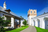 Wall with a tower and singing Corps Novodevichy Monastery — Stock Photo