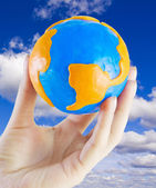 Globe in his hand — Stock Photo