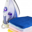 Iron and colored towel — Stock Photo #3630344