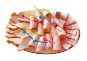 Dish with different kinds of the ham — Stock Photo
