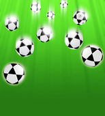 Footballs on a green background — Stock Photo
