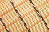 Background in the form of a straw mat — Stock Photo