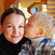 Family portrait - the child kissing mum — Stock Photo