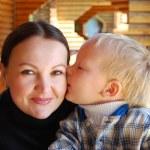 Family portrait - the child kissing mum — Stock Photo