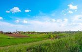 Rural landscape with meadows the sky — Stock Photo