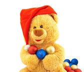 Toy bear in a Christmas cap — Foto de Stock