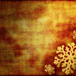 Background in gold tones decorated with snowflakes — Stock Photo