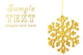 Celebratory background with large gold snowflake — Stock Photo