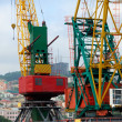Two colored port cranes — Stock Photo #3824756