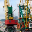 Two colored port cranes - Stock Photo