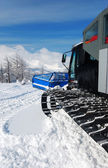 Snowcat in mountains — Stock Photo