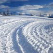 Track of snowcat - Stock Photo