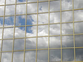 Sky reflexion in the glass house — Stock Photo
