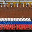 Tricolor seats and Kremlin wall fragment - Stock Photo