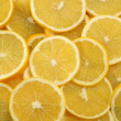 Royalty-Free Stock Photo: Abstract background with citrus-fruit of lemon slices. Close-up. Studio photography.
