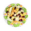 Fruit salad on colorful plate, isolated on white — Stock Photo