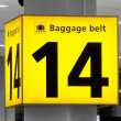Yellow baggage belt sign — Stock Photo