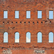 Brick wall with windows in it — Stock Photo
