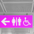 Washroom sign with male, female, disabled person silhouettes — Stock Photo