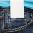 Blank business card in jeans pocket - Stok fotoğraf