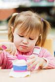 The little girl eats ice-cream — Stock Photo