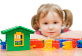 The beautiful girl with toy blocks — Stock Photo