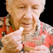 The old woman drinks a tablet — Stock Photo #2824756