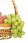 Wattled basket with grapes isolated on white — Stock Photo