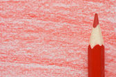 Red pencil with coloring on a paper — Stock Photo