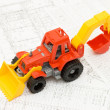 Toy yellow tractor on projects - Stock Photo