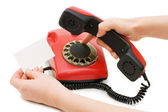 The girl dials number on red phone — Stok fotoğraf