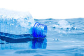 The bottle with water floats — Stock Photo