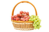 Wattled basket with grapes isolated — Stock Photo