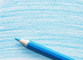 Blue pencil with coloring on a paper — Stock Photo