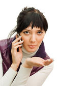 Girl speaks by phone isolated on white — Stock Photo
