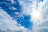 Beauty blue sky clouds and sun — Stockfoto