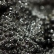 Black fish caviar close up - Stockfoto
