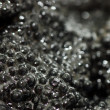 Black fish caviar close up -  