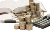 Coins and the calculator isolated — Foto Stock