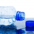Water flows from a bottle — Stock Photo