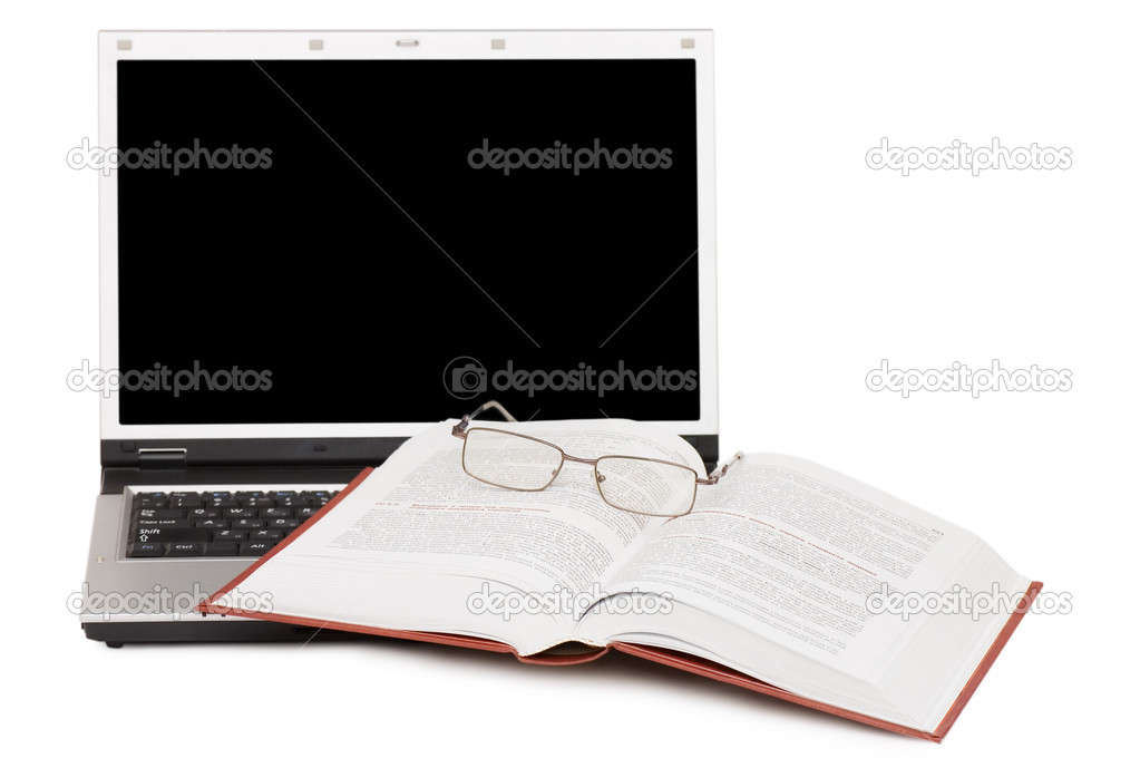 Eyeglasses and books on the laptop  — Stock Photo #3193543