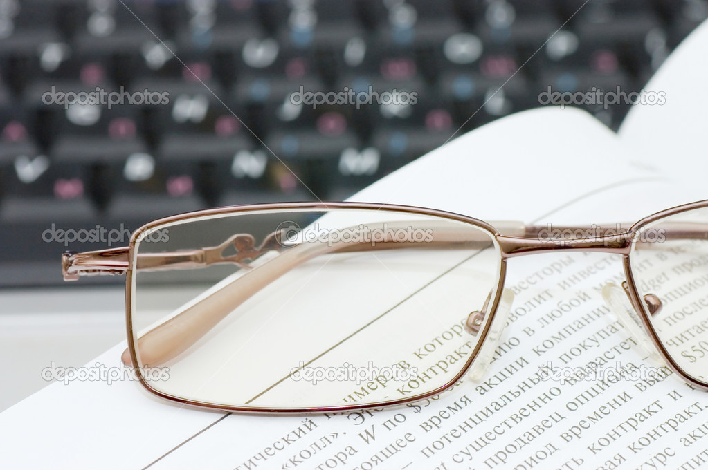 Eyeglasses and books on the laptop  — Stock Photo #3193559