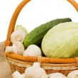 Stock Photo: Wattled basket with vegetables isolated