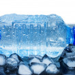 Cold water bottle with ice cubes — Stock Photo